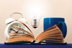 Light on the book symbolizes the idea Royalty Free Stock Images
