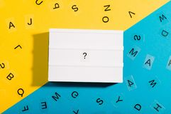 Light box with question mark on blue yellow background Stock Photos