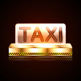 Light box on the roof of the taxi with his sword. Royalty Free Stock Photo