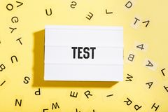 Light box with test text on yellow background Stock Photos