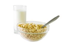 Light breakfasst. A glass of milk and a bowl of cereals Stock Photo