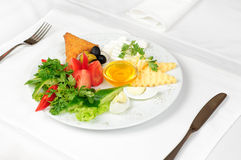 Light breakfast. Light healthy breakfast served on white tablecloth Royalty Free Stock Photography