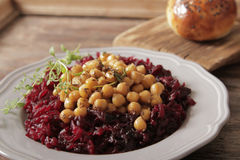 Light breakfast of beets and chickpeas. A light breakfast of beets and chickpeas along with bread royalty free stock images