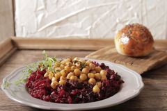 Light breakfast of beets and chickpeas. A light breakfast of beets and chickpeas along with bread stock image