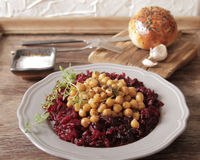 Light breakfast of beets and chickpeas. A light breakfast of beets and chickpeas along with bread stock images
