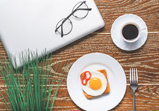 Light breakfast bounding with work Stock Photography