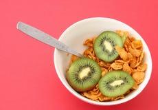Light breakfast - cornflakes with kiwi Stock Photos
