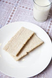 Light breakfast with crackers and milk Royalty Free Stock Photos