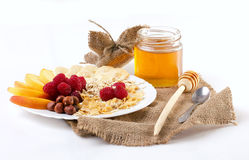 Light  breakfast with fresh fruits and honey Stock Photos