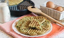 Home made waffles with spinach, heart shaped. Delicious breakfast royalty free stock photography