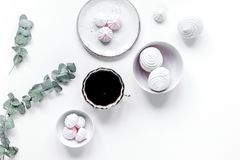 Light breakfast with marsh-mallow and coffee on white table back Stock Images