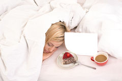 Light breakfast for sleeping blonde girl Stock Photos