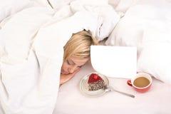 Light breakfast for sleeping blonde girl Stock Photos