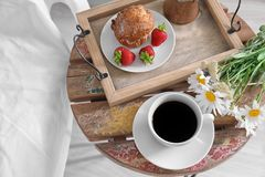 Light breakfast on the table near bed Royalty Free Stock Images