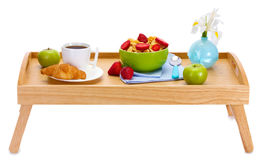 Light breakfast on wooden tray. Over the white Stock Photo