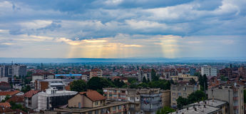 Light breaks through clouds over Peje Kosovo. Sunlight breaking through clouds over peje in kosovo Royalty Free Stock Images