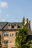 Light Brick Condos with Dormers Royalty Free Stock Photography
