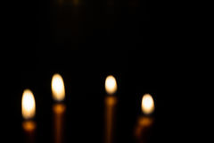 Light candle blurring. Light and bright golden yellow candle amidst darkness.Blurring image Royalty Free Stock Image
