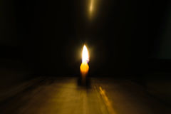 Light candle moving. Light and bright golden yellow candle amidst darkness.concept moves candle moving image Royalty Free Stock Photos