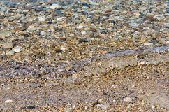 Pebble stones into the clean water. Light and bright pebble stones into the clean water Stock Photo