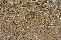 Pebble stones into the clean water. Light and bright pebble stones into the clean water Royalty Free Stock Images