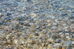 Pebble stones into the clean water. Light and bright pebble stones into the clean water Royalty Free Stock Photos