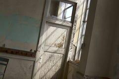 Light in broken window Royalty Free Stock Photography