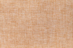 Light brown background of dense woven bagging fabric, closeup. Structure of the textile macro. Royalty Free Stock Photography