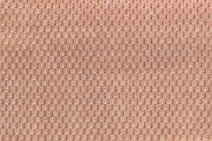 Light brown background from soft fleecy fabric closeup. Texture of textile macro Stock Images