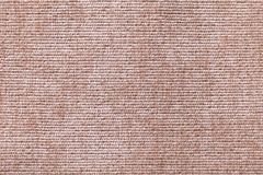 Light brown background from soft textile material. Fabric with natural texture. Royalty Free Stock Images