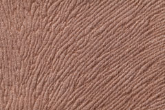 Light brown background from soft textile material. Fabric with natural texture. Royalty Free Stock Image