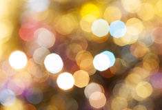 Light brown blurred shimmering Christmas lights Stock Images