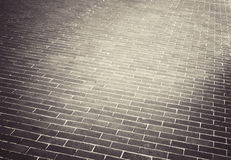Light brown brick stone street road. Sidewalk Royalty Free Stock Photography