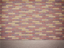 Light brown brick wall texture with sidewalk Stock Photo