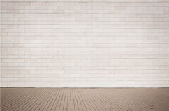Light brown brick wall texture with walkway. Stock Photos
