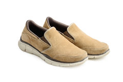 Light brown casual shoes. Over white background Stock Image