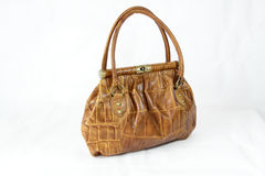 Light brown coloured crocodile skin handbag Stock Image