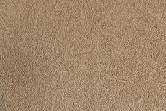 Light brown concrete stucco wall. Seamless background texture. Close-up. Royalty Free Stock Photo