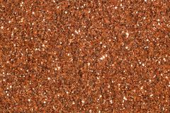 Light brown contrast background with glitter on macro. Light brown contrast background with glitter. High resolution photo royalty free stock image