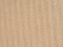 Light brown corrugated cardboard background Royalty Free Stock Images