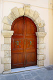 Light brown door on Crete island Stock Images