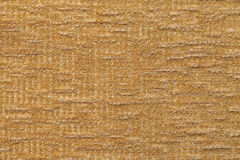 Light brown fluffy background of soft, fleecy cloth. Texture of textile closeup. Royalty Free Stock Image