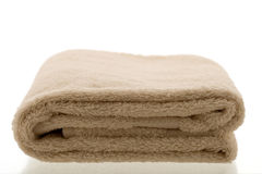 Light brown folded towel Royalty Free Stock Photos