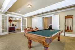 Light brown game room with billiard table. Light brown game room with green billiard table royalty free stock photos
