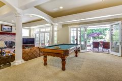 Free Light Brown Game Room With Billiard Table Stock Photos - 125187523