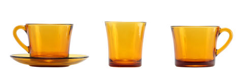 Light brown glass set isolated on white. Light brown tea cup and shot glass isolated on white Stock Images