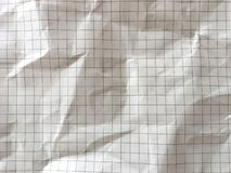 Light brown grid math paper wrinkled texture background. Rough surface pattern of graph paper royalty free stock photography
