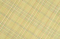 Light brown guncheck pattern on fabric. Stock Photos