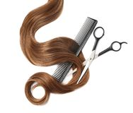 Light brown hair, comb and scissors on white background, top view. Hairdresser service stock images