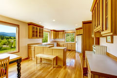 Light brown kitchen cabinets, white appliances and hardwood floor Royalty Free Stock Photo